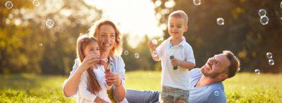 Family with children blow soap bubbles
